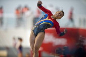 Colombia's Marcela Sandoval competes in artistic gymnastics during the X South American Games in Santiago Chile on March 8 2014 AFP PHOTO/MARTIN...
