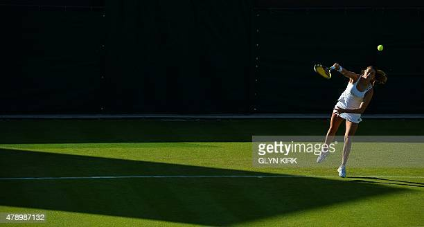 Colombia's Mariana DuqueMarino serves to Britain's Naomi Broady during their women's singles first round match on day one of the 2015 Wimbledon...