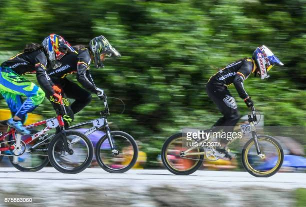 Colombia's Mariana Pajon Laura Ordonez and Maria Camila Restrepo compete in the women's BMX 20in final during the XVIII Bolivarian Games 2017 in...