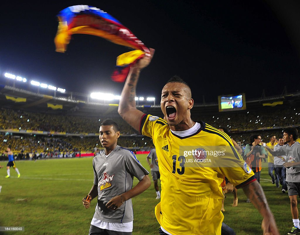 Colombia's midfielder Fredy Guarin celebrates after qualifying for the Brazil 2014 FIFA World Cup after a 3-3 tie with Chile in a South American qualifier match, in Barranquilla, Colombia, on October 11, 2013.