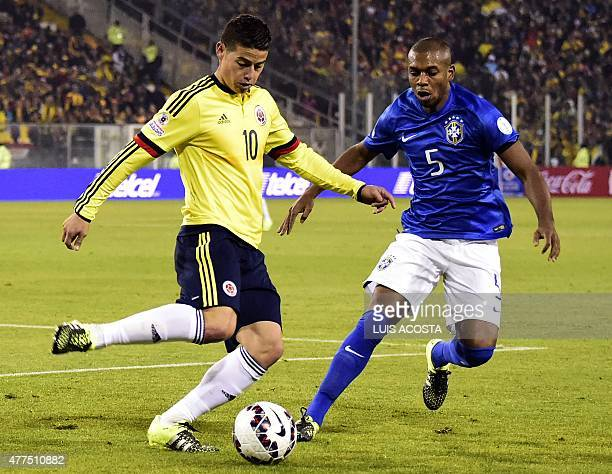 Colombia's midfielder James Rodriguez and Brazil's midfielder Fernandinho vie during their 2015 Copa America football championship match in Santiago...