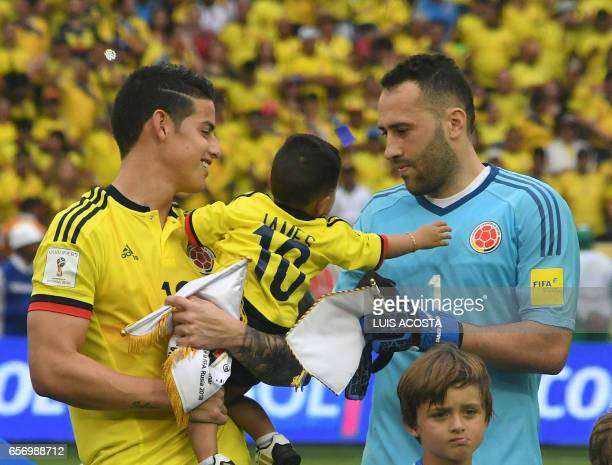 Colombia's midfielder James Rodriguez and Colombia's goalkeeper David Ospina wait for the start of the 2018 FIFA World Cup qualifier football match...