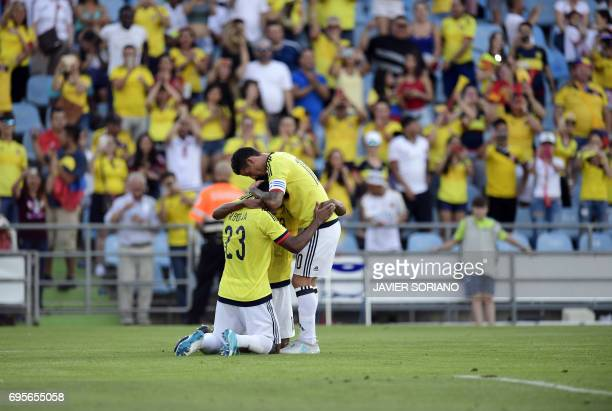 Colombia's midfielder James Rodriguez celebrates a goal with Colombia's defender Yerri Mina and Colombia's forward Miguel Borja during the friendly...