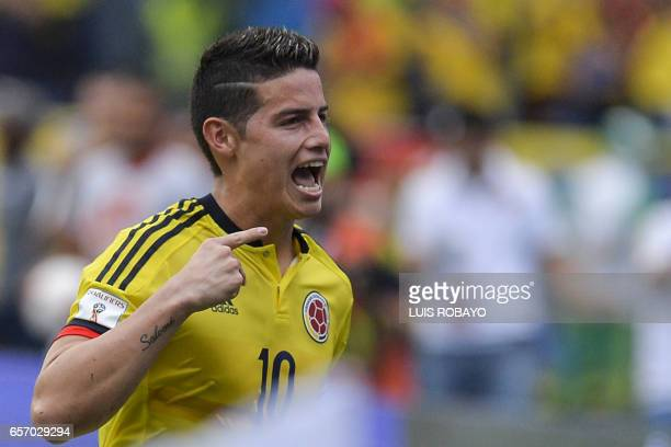Colombia's midfielder James Rodriguez celebrates after scoring against Bolivia on penalty during their 2018 FIFA World Cup qualifier football match...