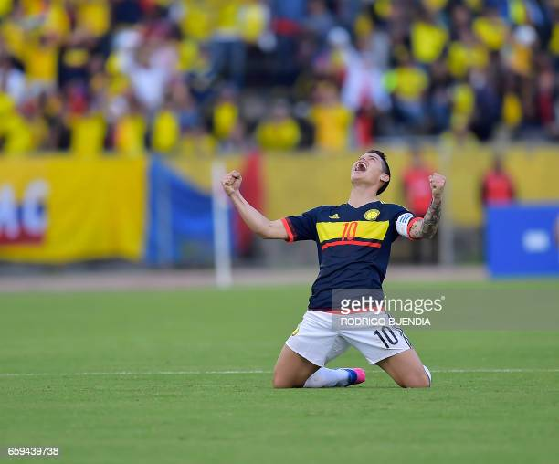 Colombia's midfielder James Rodriguez celebrates after winning 20 their 2018 FIFA World Cup qualifier football match against Ecuador in Quito on...
