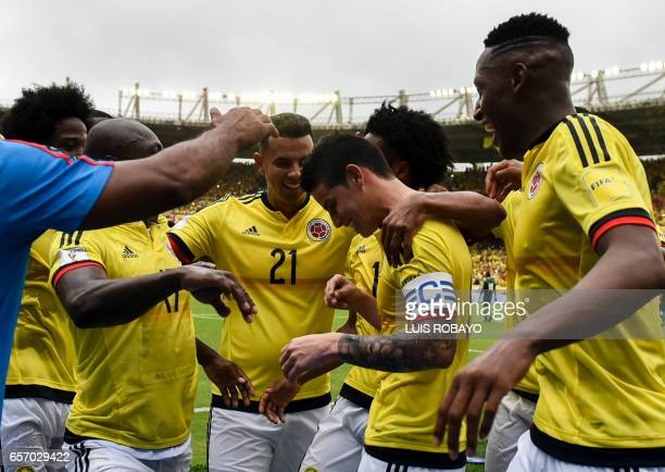 Colombia's midfielder James Rodriguez celebrates with teammates after scoring against Bolivia on penalty during their 2018 FIFA World Cup qualifier...