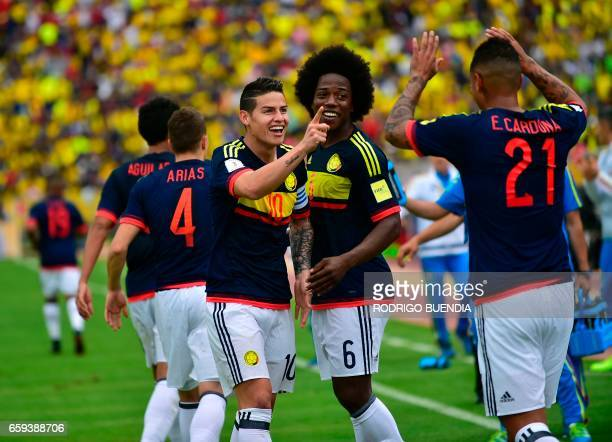Colombia's midfielder James Rodriguez celebrates with teammates after scoring against Ecuador during their 2018 FIFA World Cup qualifier football...