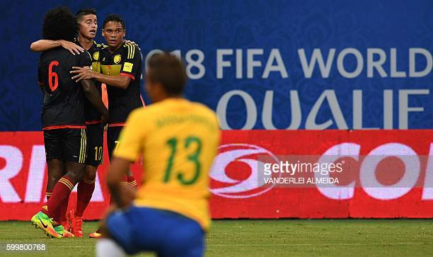Colombia's midfielder James Rodriguez Colombia's midfielder Carlos Sanchez and Colombia's forward Carlos Bacca react after an own goal by Brazil's...
