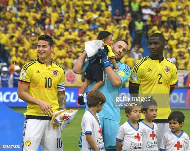 Colombia's midfielder James Rodriguez goalkeeper David Ospina and defender Cristian Zapata wait for the start of their 2018 FIFA World Cup qualifier...