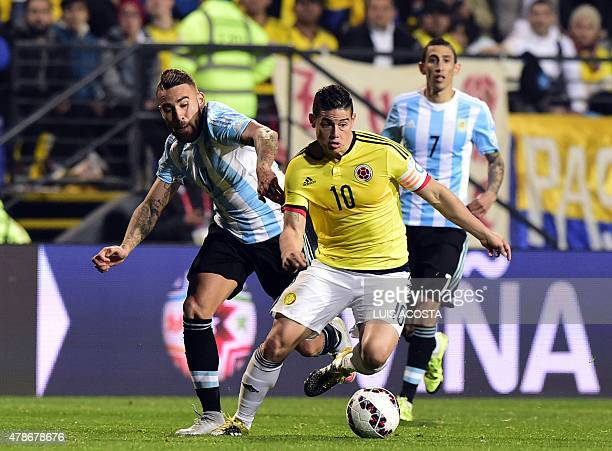Colombia's midfielder James Rodriguez is marked by Argentina's defender Nicolas Otamendi during the 2015 Copa America football championship...