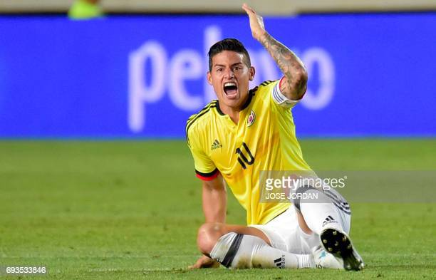 TOPSHOT Colombia's midfielder James Rodriguez protests as he sits on the field during the friendly international football match Spain vs Colombia at...