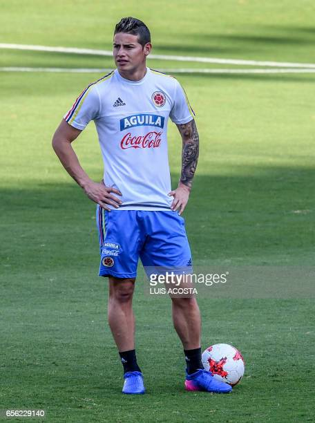 Colombia's midfielder James Rodriguez takes part in a training session at the Metropolitano Stadium in Barranquilla on March 21 2017 ahead of their...