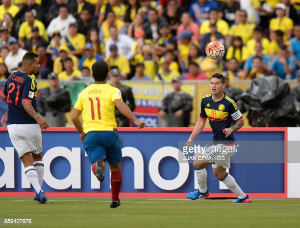 Colombia's midfielder James Rodriguez vies for the ball with Ecuador's midfielder Matias Oyola during their 2018 FIFA World Cup qualifier football...