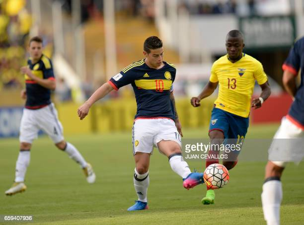 Colombia's midfielder James Rodriguez vies for the ball with Ecuador's forward Enner Valencia during their 2018 FIFA World Cup qualifier football...
