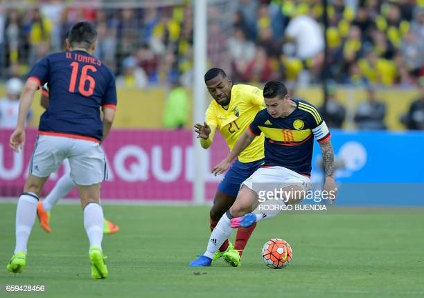 Colombia's midfielder James Rodriguez vies for the ball with Ecuador's defender Gabriel Achilier during their 2018 FIFA World Cup qualifier football...
