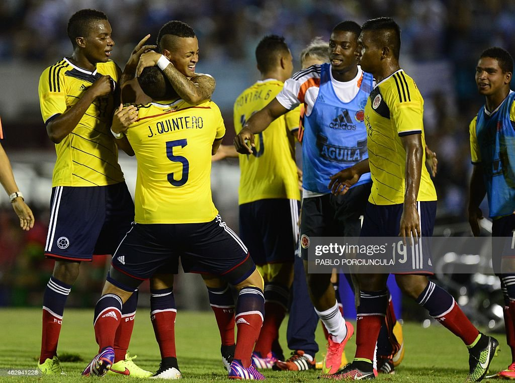 Colombia's midfielder Joao Rodriguez is embraced by captain Juan Quintero after scoring against Brazil during the South American U20 football match...