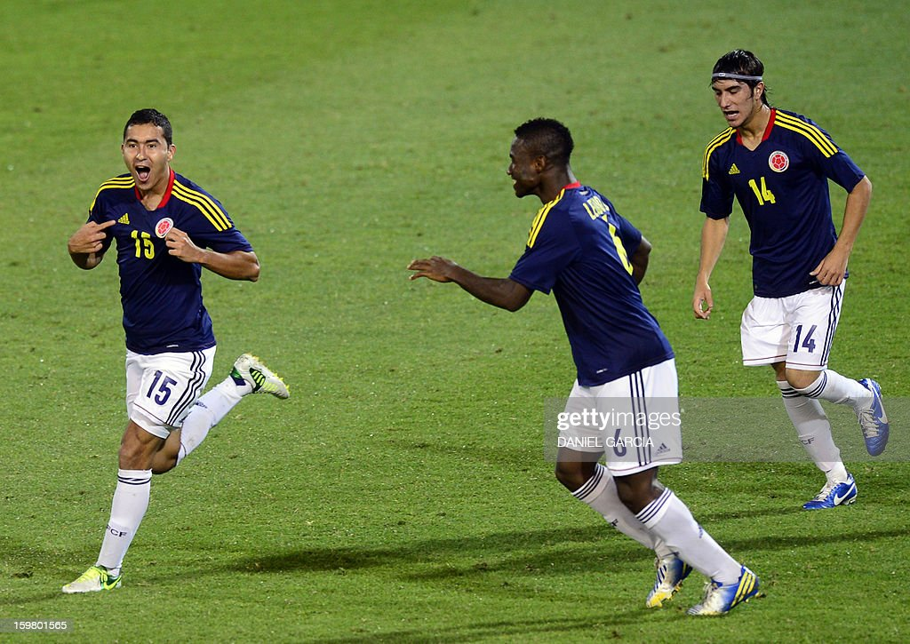 Colombia's midfielder Juan Nieto (L) celebrates with teammates after he scored against Ecuador during their South American U-20 final round football match at Malvinas Argentinas stadium in Mendoza, Argentina, on January 20, 2013. Four teams will qualify for the FIFA U-20 World Cup Turkey 2013.
