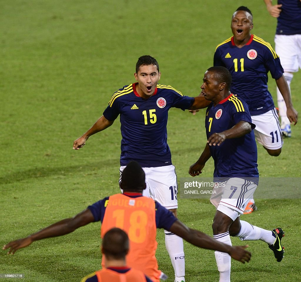 Colombia's midfielder Juan Nieto (C) celebrates with teammates after he scored against Ecuador during their South American U-20 final round football match at Malvinas Argentinas stadium in Mendoza, Argentina, on January 20, 2013. Four teams will qualify for the FIFA U-20 World Cup Turkey 2013.