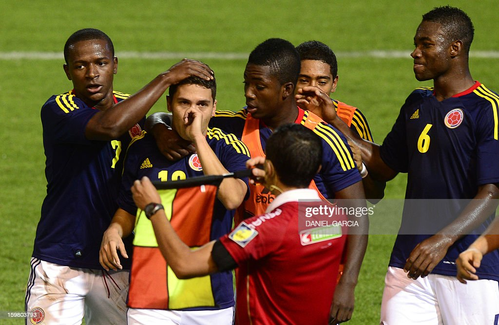 Colombia's midfielder Juan Quintero (2nd L) celebrates with teammates after he scored against Ecuador during their South American U-20 final round football match at Malvinas Argentinas stadium in Mendoza, Argentina, on January 20, 2013. Four teams will qualify for the FIFA U-20 World Cup Turkey 2013.