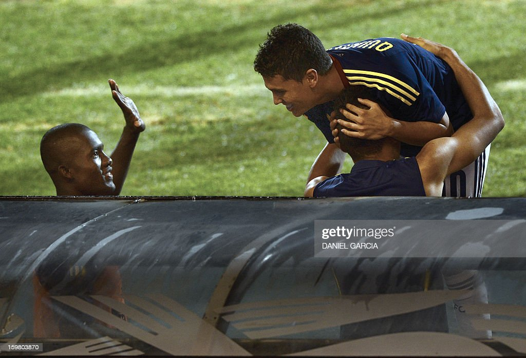 Colombia's midfielder Juan Quintero (R) celebrates with teammates after he scored against Ecuador during their South American U-20 final round football match at Malvinas Argentinas stadium in Mendoza, Argentina, on January 20, 2013. Four teams will qualify for the FIFA U-20 World Cup Turkey 2013.