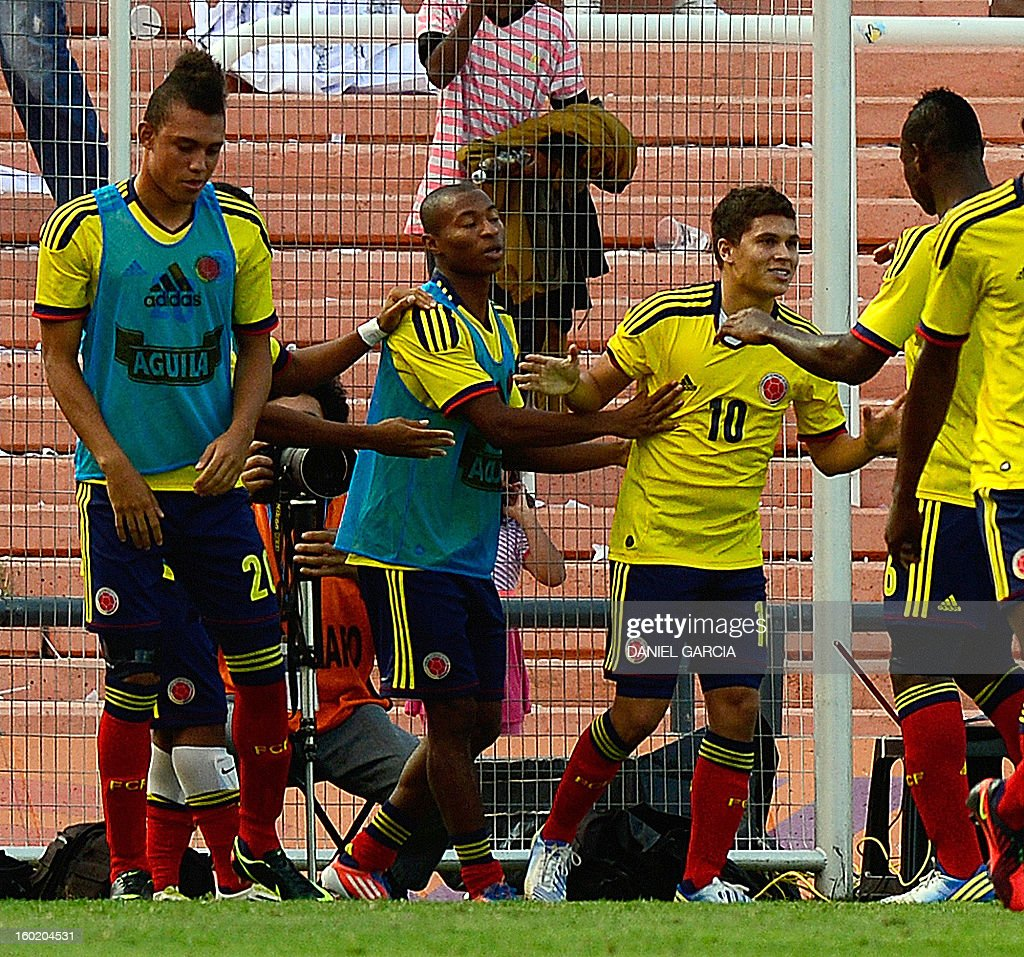 Colombia's midfielder Juan Quintero (2-R) celebrates with teammates after scoring against Peru during their South American U-20 final round football match at Malvinas Argentinas stadium in Mendoza, Argentina, on January 27, 2013. Four South American teams will qualify for the FIFA U-20 World Cup Turkey 2013.