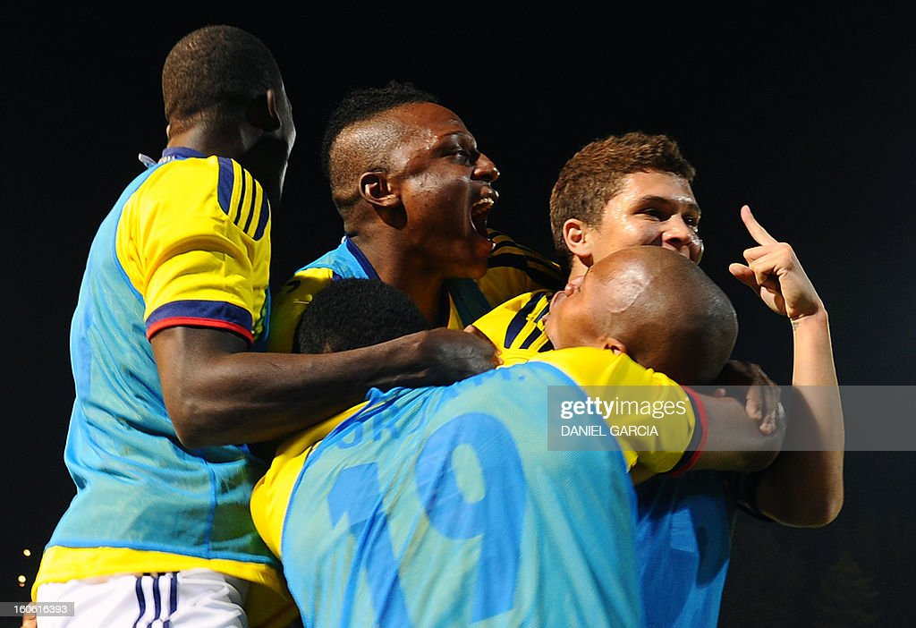 Colombia's midfielder Juan Quintero (R) celebrates with teammates after scoring against Paraguay, during their South American U-20 final round football match at Malvinas Argentinas stadium in Mendoza, Argentina, on February 3, 2013. Paraguay, Colombia, Uruguay and Chile qualified for the FIFA U-20 World Cup Turkey 2013.