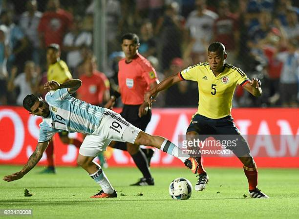 Colombia's midfielder Wilmar Barrios and Argentina's Ever Banega vie for the ball during their 2018 FIFA World Cup qualifier football match against...