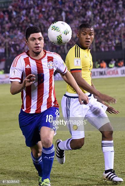 Colombia's midfielder Wilmar Barrios and Paraguay's Rodrigo Rojas vie for the ball during their Russia 2018 World Cup qualifier football match in...