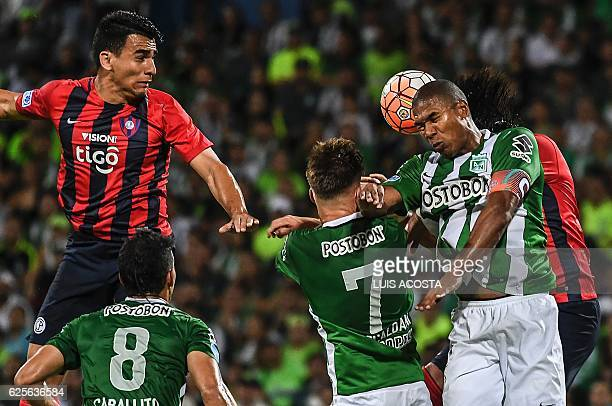 Colombia's Nacional Alexis Henriquez vies for the ball with Paraguay's Cerro Cecilio Dominguez during their Sudamericana Cup second leg semifinal...