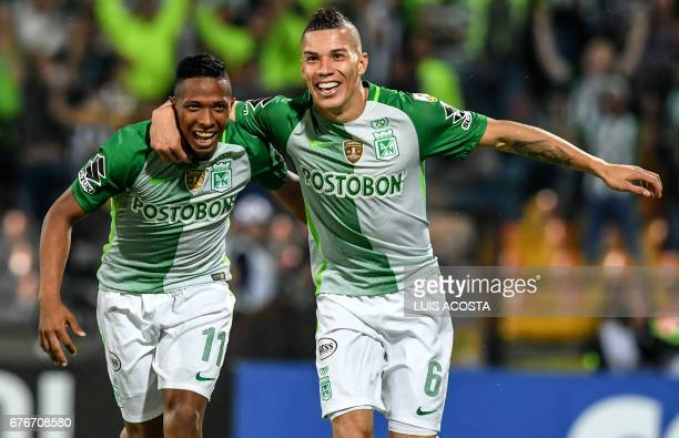 Colombia's Nacional Andres Felipe Ibarguen and Mateus Uribe celebrate the latter's goal against Argentina's Estudiantes de La Plata during their Copa...