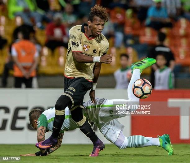 Colombia's Nacional Dairo Moreno vies for the ball with Ecuador's Barcelona player Dario Aimar during their Copa Libertadores 2017 football match at...