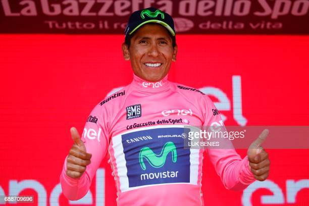Colombia's Nairo Quintana of Movistar team celebrates his overall leader pink jersey on the podium at the end of the 19th stage of 100th Giro...