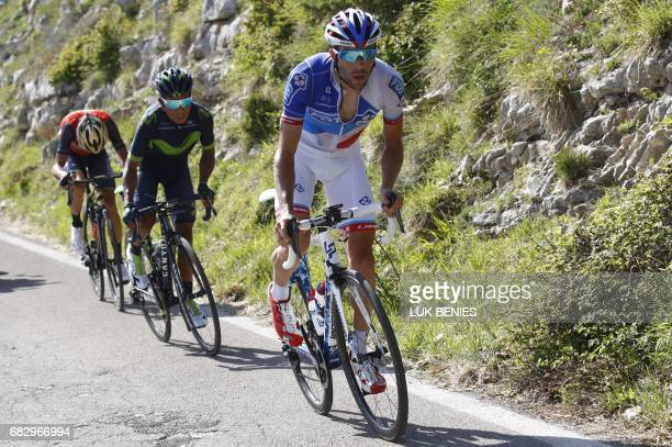 Colombia's Nairo Quintana of team Movistar climbs the Blockhaus with France's Thibaut Pinot of team FDJ and Italy's rider of team Bahrain Merida...