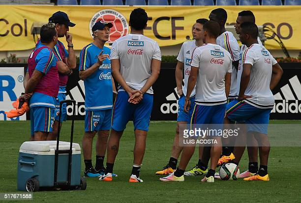 Colombia's national football team coach Argentinian Jose Pekerman gives instructions to his players during a training session at the Metropolitano...