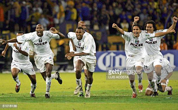Colombia's Once Caldas players celebrate getting the Libertadores Cup after defeating Argentina's Boca Juniors 01 July 2004 in Manizales Once Caldas...