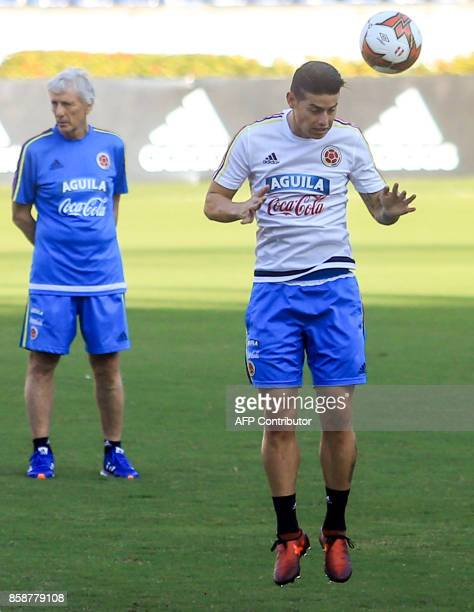Colombia's player James Rodriguez next to coach Jose Pekerman headst the ball during a training session at the Metropolitano Stadium in Barranquilla...