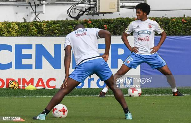 Colombia's Player Juan Cuadrado takes part in a training session at the Metropolitano Stadium in Barranquilla on October 3 ahead of their FIFA 2018...