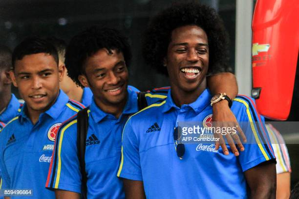 Colombia's players Carlos Sanchez Juan Cuadrado and Luis Muriel smile on the way to the Ernesto Cortissoz International Airport in Barranquilla...