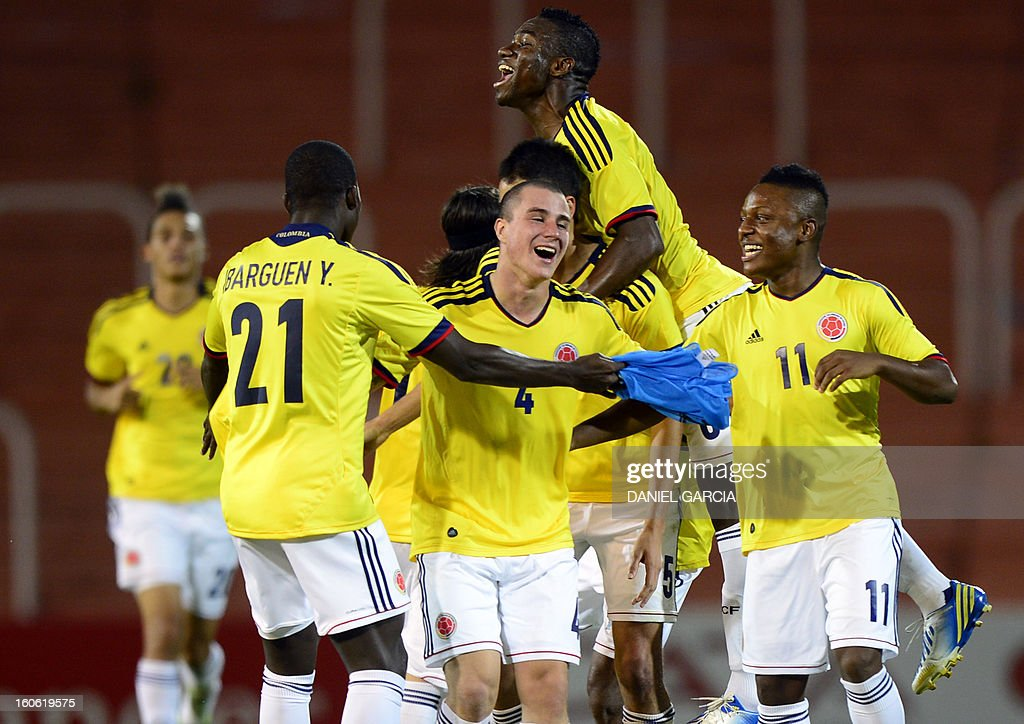 Colombia's players celebrate at the end of their South American U-20 final round football match against Paraguay at Malvinas Argentinas stadium in Mendoza on February 3, 2013. Colombia won 2-1. Four teams will qualify for the FIFA U-20 World Cup Turkey 2013.