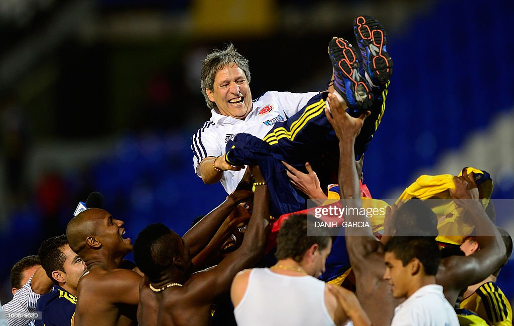 Colombia's players celebrate with coach Carlos Restrepo (C) at the end of their South American U-20 final round football match against Paraguay at Malvinas Argentinas stadium in Mendoza on February 3, 2013. Colombia won 2-1. Four teams will qualify for the FIFA U-20 World Cup Turkey 2013.