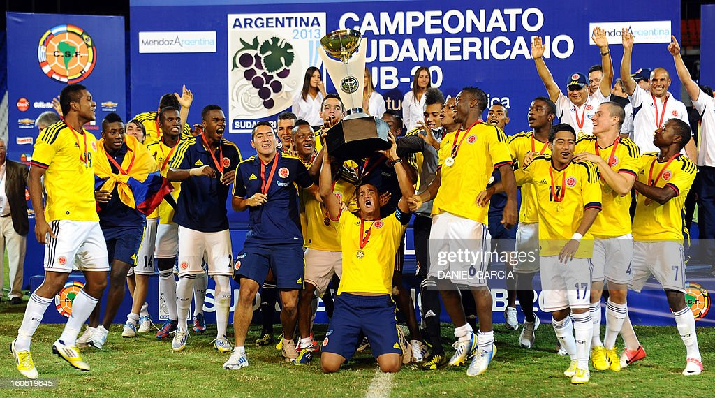 Colombia's players celebrate with the trophy at the podium after winning the championship of their South American U-20 final round football match against Paraguay at Malvinas Argentinas stadium in Mendoza on February 3, 2013. Colombia defeated Paraguay 2-1, and both teams plus Uruguay and Chile qualified for the FIFA U-20 World Cup Turkey 2013.