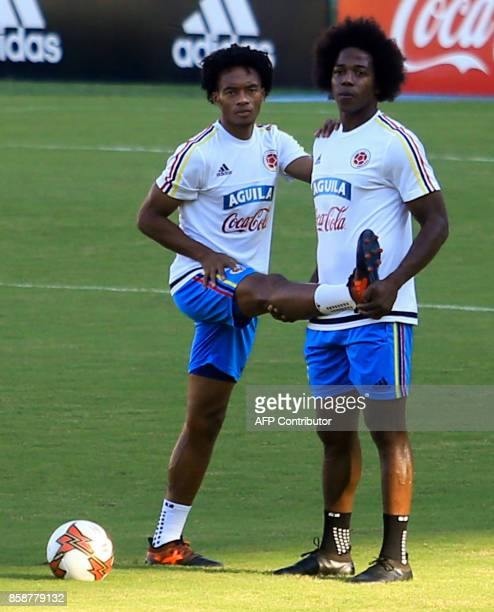 Colombia's players Juan Guillermo Cuadrado and Carlos Sanchez take part in a training session at the Metropolitano Stadium in Barranquilla on October...