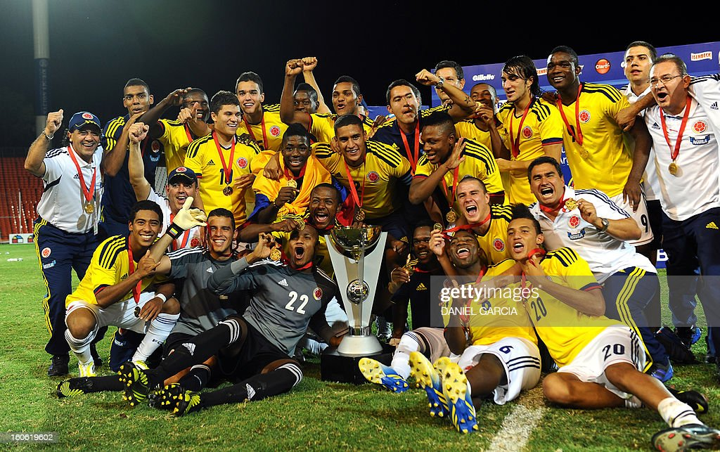 Colombia's players pose together as they celebrate with the trophy at the podium after winning the championship of their South American U-20 final round football match against Paraguay at Malvinas Argentinas stadium in Mendoza on February 3, 2013. Colombia defeated Paraguay 2-1, and both teams plus Uruguay and Chile qualified for the FIFA U20 World Cup Turkey 2013.