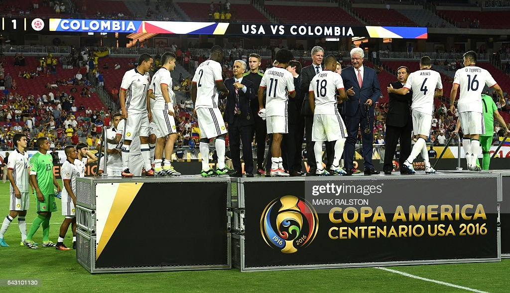 Colombia's players receive their medals after winning the Copa America Centenario third place football match against the USA in Glendale, Arizona, United States, on June 25, 2016. / AFP / Mark RALSTON