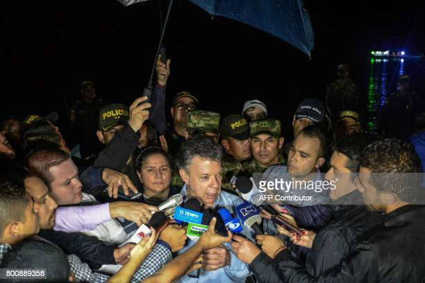 CORRECTION Colombia's President Juan Manuel Santos is interviewed after arriving at the scene where the tourist boat Almirante sank in the Reservoir...