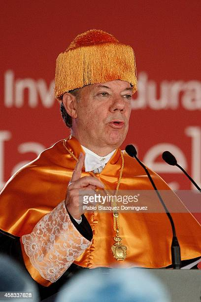 Colombia's President Juan Manuel Santos speaks during a ceremony where he receives an Honorary Doctorate at the Camilo Jose Cela university on...