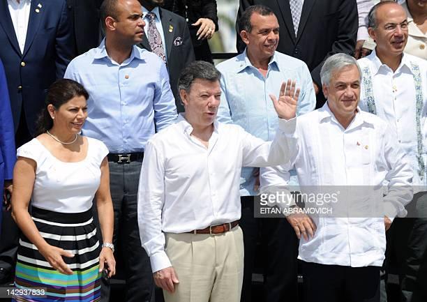 Colombia's President Juan Manuel Santos waves next to Costa Rica's President Laura Chinchilla Haiti's Foreign Minister Laurent Lamothe Honduras'...