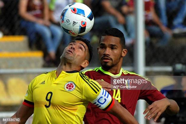 Colombia's Radamel Falcao and Venezuela's Yangel Herrera vie for the ball during their 2018 World Cup qualifier football match in San Cristobal...