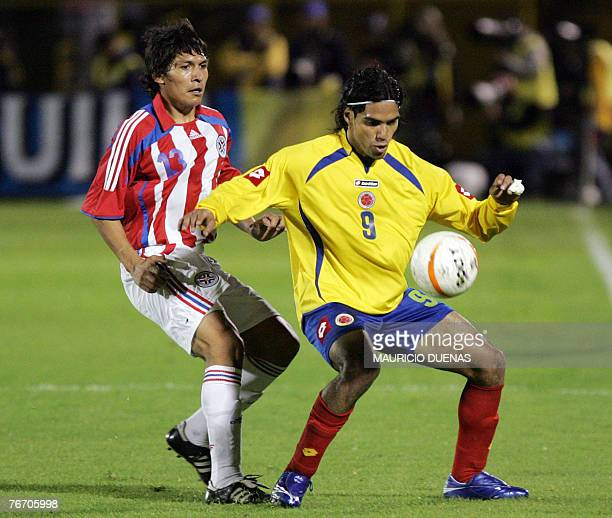 Colombia's Radamel Falcao Garcia vies for the ball with Paraguay's Jorge Nuez during a friendly match 12 September 2007 in Bogota prior to their...