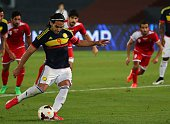 Colombia's Radamel Falcao shoots to score a penalty against Kuwait during their friendly football match at the Sheikh Zayed Stadium in Abu Dhabi on...